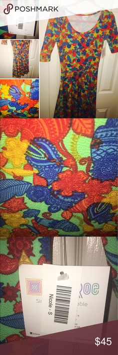 LuLaRoe Nicole Paisley Red/Blue/Sea Foam! NWT Size Small. Excellent Fabric (see texture in photos). Fits size 6-8 best. 3/4 length sleeves, stretchy! Fits super well. Great for teachers, business casual, date night, weddings! Moving and need to sell! LuLaRoe Dresses Midi