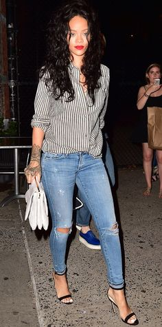 Rihanna elevated her destroyed denim skinnies with an oversize gray-and-white striped button-down, a handlebar clutch, and ankle-strap sandals. #InStyle