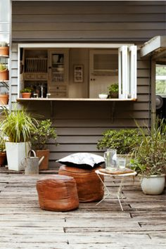 I like this window idea for the kitchen over the sink...great way to pass out the food for outdoor eating and entertaining-outdoor bar with stools