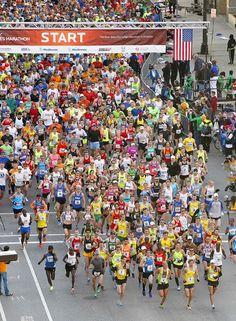 Runners begin the Medtronic Twins Cities Marathon in Minneapolis, Sunday Oct. 6, 2013.