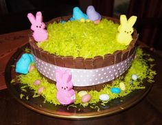 Oh my! A cake wrapped in kit kats and ribbon and topped with colored coconut! How cute for Easter!!