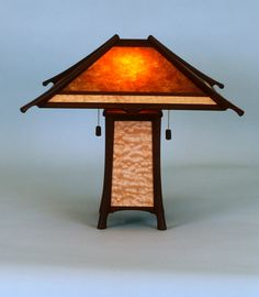 """Wood and Mica table lamp. This lamp is one of the """"Tea House Series"""" lamps I designed and built back in the day. This lamp has a Peruvian walnut framework with Pacific maple panels and mica shade. Davie Hannaford Jr. DBA The Seven Lamps 1996 - 2009"""