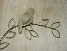Toilet paper roll bird, branch and leaves
