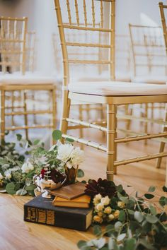 Old books and flowers lined the aisle at this elegant + vintage inspired wedding in Vancouver  | Image by Sara Rogers Photography