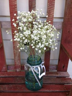 """25th wedding anniversary party decor or centerpiece. Ball jar, baby's breath sprayed with silver glitter spray, silver ribbon and """"25"""" cut outs threaded through ribbon. Simple and stunning!"""