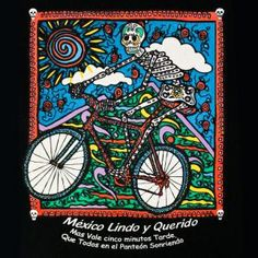 """""""It is better to be five minutes late then dead"""". Show off your humor for the macabre with this Mexico Lindo (Beautiful Mexico) day of the dead T-Shirt. This shirt will also make a great gift for the cyclist in your life. Viva la bicicleta! Long live the Bicycle!"""