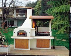 Tiled roof Argentine parrilla and oven with shared chimney