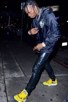 2a5a7dc52c525 Travis Scott wearing Saint Laurent Faux Leather Jeans