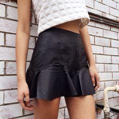 Black leather peplum skirt