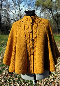 Ravelry: Cabled Fall Celebration Cape pattern by Willa Schrlau