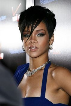 love the blue/silver eyeshadow and brown crease/contour. rihanna_varied_length_bangs_hairstyle