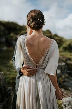 See more pictures here: http://www.whitneyjustesen.com/whitney-justesen-photography/2017/11/16/connemara-day-before-session The Whitney wedding dress is made in a very non-traditional color mix with lots of draped silk and a very delicate button lace back detail. The plunging V backline