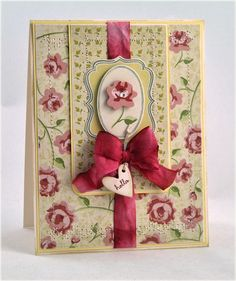 I really like what Debbie Olson does with cards - this one has some fun colors, stitching, stamping and seam binding.  Papers are 'Tea for Two' from Cosmo Cricket.