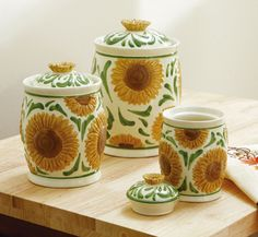 I would love to have a Sunflower Kitchen theme kitchen... and my brown drip dinnerware would look good with these still.
