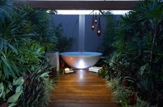 Rain shower above the bathtub in the patio!