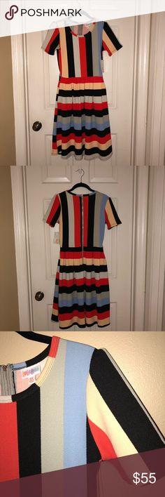 Lularoe Amelia XS Striped Dress NWT Lularoe Amelia XS (size 2-4) Striped Dress with hidden pockets.  Red/Orange, Black, Cream, Light Green, and Light Blue.  It's super soft and super stretchy.  New with tags. LuLaRoe Dresses