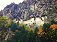 Sumela Monastery in Turkey was founded in the year 386 by two Athenian priests - Barnabas and Sophronius.  It clings to the wall of a steep cliff facing the Altındere valley in the region of Macka in Trabzon Province, Turkey.