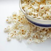 Packed with fiber, air-popped popcorn is a great snack to keep you full until your next meal. Add these toppings to make the snack, well, pop.