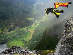 Competitors Frode Johannessen, right, and Ronny Risvik, left, take to the skies