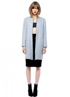 """Collarless brushed wool coat with an oversized fit and exposed front zip closure. Fully lined; pockets at waist. 35"""" length."""
