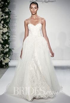 Brides.com: Dennis Basso for Kleinfeld - 2015%0AStyle 14044, strapless beaded and embroidered tulle sheath wedding dress with a sweetheart neckline, scalloped hem, and removable tulle overskirt, Dennis BassoPhoto: Thomas Iannacone