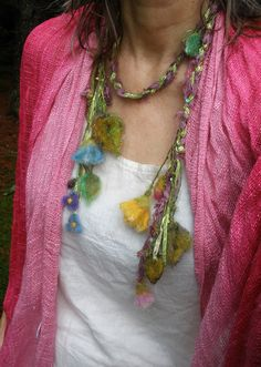 For inspiration:  Handmade item.  Materials: silk ribbons, hand dyed wool, sparkle threads, rayon shimmer.  silky adornment/scarf/lariat from the enchanted forest