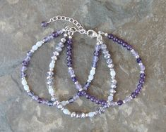 This multistrand gemstone bracelet is handmade with amethyst and fire polished glass beads. Finished with a sterling silver lobster clasp and adjustable chain. The birthstone of February, Amethyst is a calming stone that promotes peace and helps to reduce anxiety and stress. It