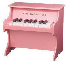 Ce joli piano en bois laqué rosede la marque New Classic Toys est un bon apprentissage à l'éveil musical.  Avec ces 11 touches blanches et 7 touches noires, ce piano propose plusieurs sons différents.  Dimensions : L 32 x P 25 x H 29 cm