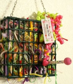 if you have old suet cages lying around -- Bird nesting material: recycled yarn with polka dot perch