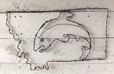 MT Fish Wire Wall Art | Distinctly Montana Gift Ideas for the Holidays - Artisan Shane Skinner creates this fluid barbed wire design of a fish within an outline of the state of Montana. Perfect western decor for your rustic home or cabin.