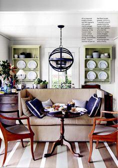 love the light fixture, green flanked bookshelves, rug, etc...