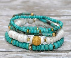 Summertime mix of turquoise blue, white shell & gold accents. SET OF 4.    Bracelets comfortably fit up to size 7 wrist.    To see the full collection