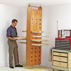 Drop-Down Drying Rack Woodworking Plan from WOOD Magazine....(Maybe add pegboard shelving on pvc, triangles with pegs to set various sized projects on..able to stain more at once)