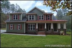 2707 Sq Ft home with 4 bedrooms, 3.5 bathrooms. Craftsman style exterior with red metal roof, stone base columns.