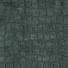 Wally - Teal Upholstery Interior Fabric. Chenille Fabric embossed with an animal skin pattern. Bright teal blue tone on tone.  Suitable for Drapery, Bedding, Pillows & Upholstery.