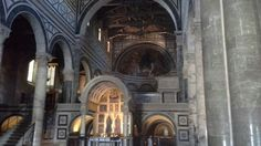 Mosaic in the great apse and the altar with the marble aedicole designed by Michelozzo.