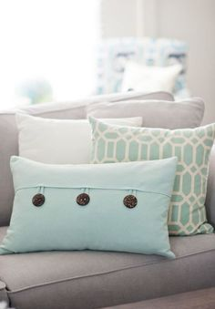 I like the style of these. I think I could sew similar for our couch