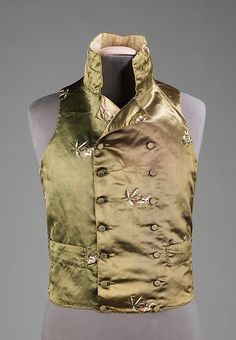 This very elegant vest is indicative of the taste for very high stand collars alongside double-breasted waist-length styles which came into focus near the end of the 18th century. The embroidered flowers are a remnant of the styles of the previous century and indicate the transition into the heavily patterned woven textiles used for vests in the 1820s.