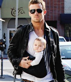 Cam Gigandet and a smouldering baby...i honestly don't know which face is better!