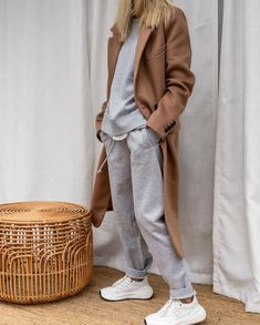 Elevating the working from home sweat suit look with a camel coat and white sneakers