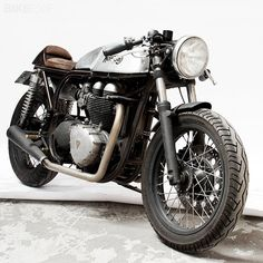 perfect cafe. modern triumph motor in reproduction norton feather bed frame.