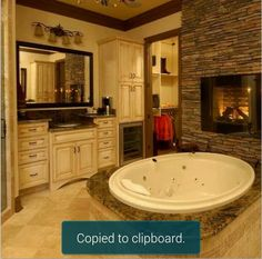 Soaker tub with fireplace
