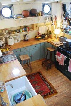 blue cabinets and wooden butcher block countertops, farmhouse sink, tile floorin. blue cabinets an Rustic Kitchen, Kitchen Dining, Kitchen Decor, Kitchen Ideas, Gypsy Kitchen, Eclectic Kitchen, Cozy Kitchen, Kitchen Cupboards, Kitchen Cart