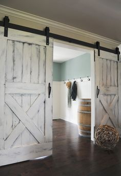 Sliding barn doors on exposed hardware.