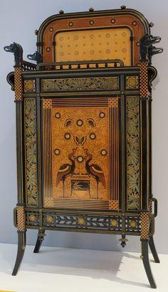 High Museum of Art  Cabinet, 1875, ebonized cherry, veneer inlays, and metallic foil decorative paper.