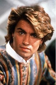 1980's: George Michael (WHAM!) in a Cliff Huxtable (BILL COSBY) sweater...and double hoop earings, to boot.