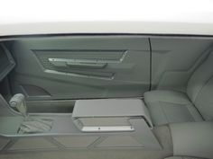 Pegasus street rod style upholstery interiors.custom dash door panels and console to the honeycomb stamped leather seats. Goolsby's Customs, 71 Mustang grey white modern panel