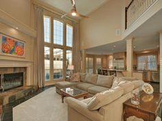 Soaring 2-story family room with elegant fireplace and huge picture windows 1808 Lemon Mint Ct, Austin TX 78733