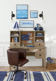 Fashion designer Monique Lhuillier was inspired by her son, Jack's, love of the beach when designing this study space. The seascape art pieces were created by a local San Francisco artist to balance the natural hardwood desk and leather club chair. Because a kid's space can be stylish too!