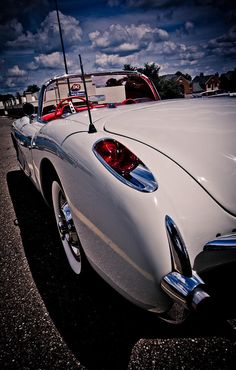 Classic Corvette with white puffy clouds! SHOP SAFE! THIS CAR, AND ANY OTHER CAR YOU PURCHASE FROM PAYLESS CAR SALES IS PROTECTED WITH THE NJS LEMON LAW!! LOOKING FOR AN AFFORDABLE CAR THAT WON'T GIVE YOU PROBLEMS? COME TO PAYLESS CAR SALES TODAY! Para Representante en Espanol llama ahora PLEASE CALL ASAP 732-316-5555